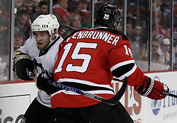 Dec 30, 2009; Newark, NJ, USA; Pittsburgh Penguins defenseman Alex Goligoski (3) is hit by New Jersey Devils right wing Jamie Langenbrunner (15) during the second period at the Prudential Center.