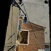 Italy, Veneto, Venice. November/12/2007...Looking up - texture and facades in the city of Venice, Italy...