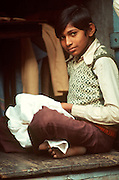 INDIA, PORTRAITS Portrait of a young boy working as a tailor in Agra