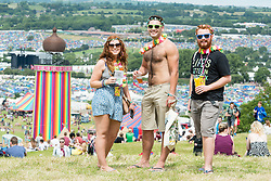 © Licensed to London News Pictures. 24/06/2015. Pilton, UK.   Festival goers at Glastonbury Festival enjoy a warm sunny afternoon on  Wednesday Day 1 of the festival.        The pedestrian gates to the festival opened at 8am this morning, with many festival goers arriving and waiting throughout last night for the opening.  This years headline acts include Kanye West, The Who and Florence and the Machine, the latter having been upgraded in the bill to replace original headline act Foo Fighters.  Photo credit: Richard Isaac/LNP