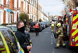 © Licensed to London News Pictures. 18/01/2019. London, UK. Emergency services at the scene in Balham, south London where police are negotiating with a man who is inside the house with a knife. Photo credit: Peter Macdiarmid/LNP