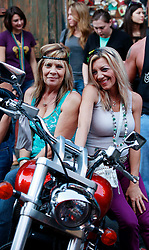 27 Jan 2013. New Orleans, Louisiana USA. .Biker ladies sitting in the French Quarter..Photo; Charlie Varley