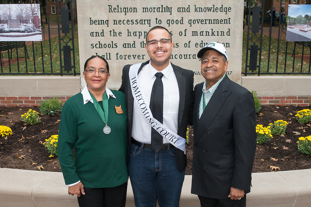 Ohio University President, Roderick McDavis, and Ohio University First Lady, Deborah McDavis, pose with Devin Sudman, a member of Ohio University's Homecoming Court, at the College Gateway on October 8, 2016.