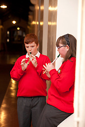 Repro Free: 18/10/2012 Pupils of ChildVision, the national education centre for blind children, Paul Geoghegan (12) from Tallaght and Jasmine Boyle (12) from Finglas practice as they await Michael Flatley who launched a unique album of traditional Irish music featuring music made famous by blind musicians and now played by a new generation of sightless players at Woodlock Hall, All Hallows College, Drumcondra. The brainchild of Catherine McGorman the venture was supported by the Arts Council and all funds raised will go to supporting music teaching for blind and partially sighted children at ChildVision. Pic Andres Poveda.