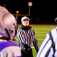 110912       Cable Hoover<br /> <br /> The Miyamura Patriots and Gallup Bengals watch as head referee Jesse Hankins makes to coin toss to start their game Friday at Public School Stadium.