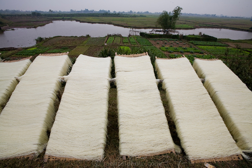 Noodles are set out to dry on racks in So village, southwest of Hanoi, Vietnam.