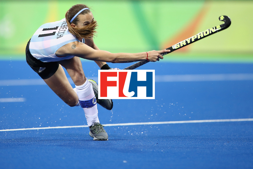 RIO DE JANEIRO, BRAZIL - AUGUST 10:  Carla Rebecchi of Argentina shoots at goal during the women's pool B match between Great Britain and Argentina on Day 5 of the Rio 2016 Olympic Games at the Olympic Hockey Centre on August 10, 2016 in Rio de Janeiro, Brazil.  (Photo by Mark Kolbe/Getty Images)