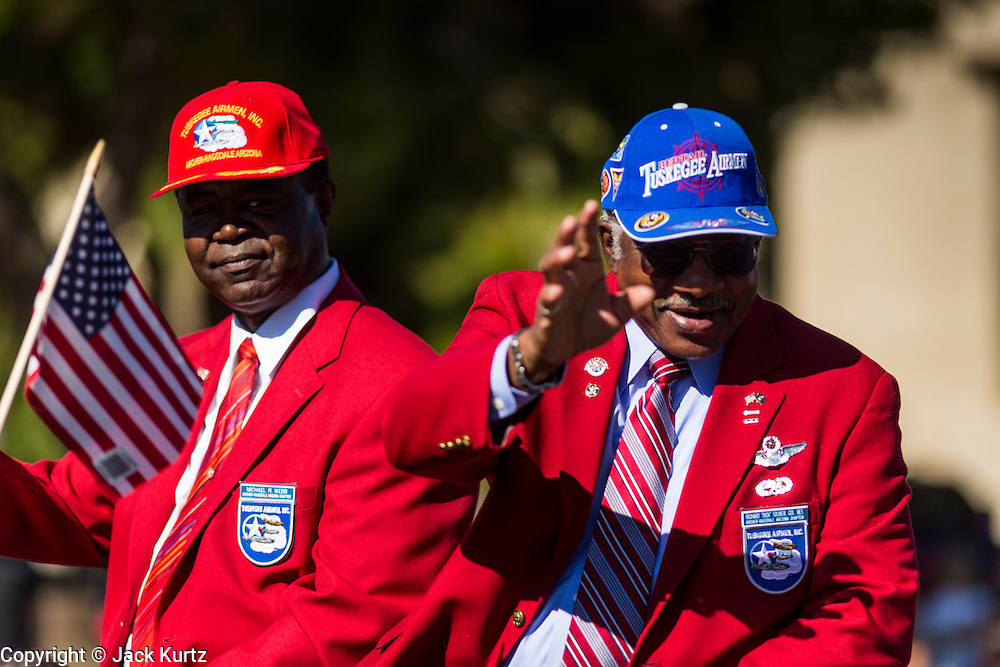 "11 NOVEMBER 2013 - PHOENIX, AZ: MICHAEL WEBB and RICHARD ""Dick"" TOLIVER, both veterans of the Tuskegee Airmen, an all African-American fighter squadron in World War II, at the Phoenix Veterans Day Parade. The Phoenix Veterans Day Parade is one of the largest in the United States. Thousands of people line the 3.5 mile parade route and more than 85 units participate in the parade. The theme of this year's parade is ""saluting America's veterans.""    PHOTO BY JACK KURTZ"
