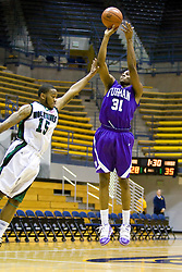 December 29, 2009; Berkeley, CA, USA;  Furman Paladins forward Amu Saaka (31) shoots over Utah Valley Wolverines guard Tyray Petty (15) during the first half at the Haas Pavilion.  Furman defeated Utah Valley 77-69.