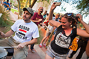 14 OCTOBER 2011 - PHOENIX, AZ:   A woman dances while a band performs at the Occupy Phoenix march Friday. About 300 people participated in the Occupy Phoenix march through downtown Phoenix Friday evening, Oct. 14. The march was the first event in the Occupy Phoenix protests which start with the occupation of Cesar Chavez Plaza, a large square in downtown Phoenix. PHOTO BY JACK KURTZ