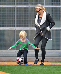 (UK RIGHTS ONLY) Naomi Watts and Liev Schreiber enjoy a game of football with their son Samuel in Tribeca, NYC, USA. 17/10/2012 <br />