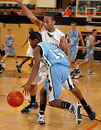 4 FEB. 2010 -- WEBSTER GROVES, Mo. -- Parkway West's Charles Thomas (15) attempts to advance the ball against pressure from Webster Groves' James Kenner (11) during the game Thursday, Feb. 4, 2010 between Webster Groves and Parkway West at Webster Groves High School. Photo (c) copyright by Sid Hastings.