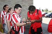 Tahvon Campbell signs a autograph  before the EFL Sky Bet League 2 match between Cheltenham Town and Swindon Town at Jonny Rocks Stadium, Cheltenham, England on 24 August 2019.