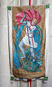 Interior of the priory church at Edington, Wiltshire, England, UK - banner of Saint George killing the dragon