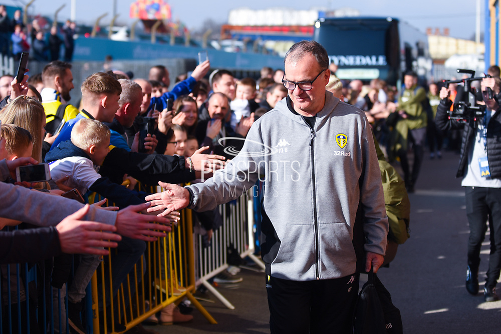 Marcelo Bielsa of Leeds United (Manager) greets fans as he arrives at the ground before the EFL Sky Bet Championship match between Leeds United and Bolton Wanderers at Elland Road, Leeds, England on 23 February 2019.