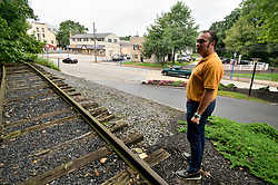Mayor Peter Ursucheler stands at a small abounded stretch of railroad that remains along Bridge Street, near the former train station, in Phoenixville, PA, on august 21, 2018.
