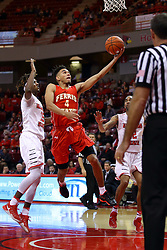 26 November 2016:  Drew Cushingberry get past Andre Washington(15) for a layup during an NCAA  mens basketball game between the Ferris State Bulldogs the Illinois State Redbirds in a non-conference game at Redbird Arena, Normal IL