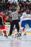 PENTICTON, CANADA - SEPTEMBER 17: Referee Anderson stands at centre ice between the Calgary Flames and the Edmonton Oilers on September 17, 2016 at the South Okanagan Event Centre in Penticton, British Columbia, Canada.  (Photo by Marissa Baecker/Shoot the Breeze)  *** Local Caption ***