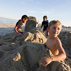 Kids playing at Hampton Beach in Hampton Beach, New Hampshire.