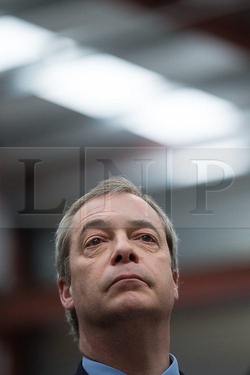 © Licensed to London News Pictures . 23/03/2015 . Middleton , UK . NIGEL FARAGE sits in the audience as Patrick O'Flynn speaks . UKIP leader Nigel Farage , Deputy Leader Paul Nuttall and Economics Spokesman Patrick O'Flynn announce UKIP's economic policy at Concept Metal Products and Co Ltd in Middleton , Lancashire . Photo credit : Joel Goodman/LNP