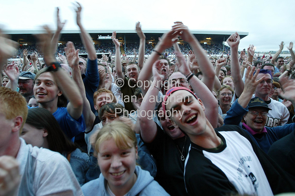 28/7/2002 Irish Examiner.The crowd pictured at the Paul Simon concert at the Smithwicks Source Festival in Nowlan Park on Saturday..Picture Dylan Vaughan