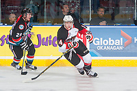 KELOWNA, CANADA - DECEMBER 5: Colby McAuley #14 of Prince George Cougars skates against the Kelowna Rockets on December 5, 2014 at Prospera Place in Kelowna, British Columbia, Canada.  (Photo by Marissa Baecker/Shoot the Breeze)  *** Local Caption *** Colby McAuley;
