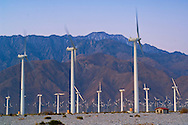 Array of windmills at wind farm at dawn, below the San Jacinto Mountains, Palm Springs, California