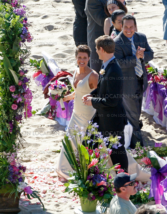 LOS ANGELES, CALIFORNIA - WEDNESDAY 25TH FEBRAURY 2009. EXCLUSIVE: TV show 'Chuck' filming a wedding scene on the beach in Malibu. Sarah lancaster and Ryan Mcpartlin (a.k.a. Captin Awsome) are the bride and groom and Zachary Levi who plays Chuck is the Best Man. Photograph: On Location News. Sales: Eric Ford 1/818-613-3955 info@OnLocationNews.com