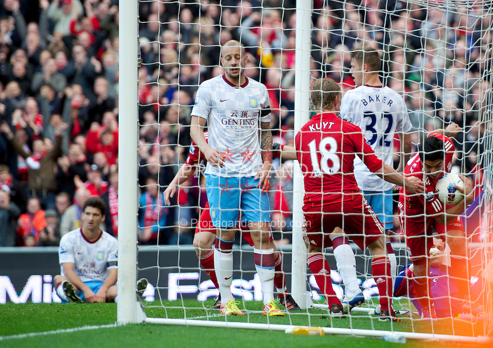 LIVERPOOL, ENGLAND - Saturday, April 7, 2012: Liverpool's Luis Alberto Suarez Diaz celebrates scoring a late equalising goal against Aston Villa but it wasn't enough as the Reds slumped to a 1-1 draw during the Premiership match at Anfield. (Pic by David Rawcliffe/Propaganda)