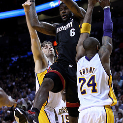 March 10, 2011; Miami, FL, USA; Miami Heat small forward LeBron James (6) looks to pass as Los Angeles Lakers shooting guard Kobe Bryant (24) and power forward Pau Gasol (16) defend during the fourth quarter at the American Airlines Arena. The Heat defeated the Lakers 94-88.   Mandatory Credit: Derick E. Hingle