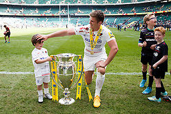Saracens Fly-Half Owen Farrell and his younger brother share a moment with the trophy after Saracens win the Aviva Premiership - Photo mandatory by-line: Rogan Thomson/JMP - 07966 386802 - 30/05/2015 - SPORT - RUGBY UNION - London, England - Twickenham Stadium - Bath Rugby v Saracens - 2015 Aviva Premiership Final.