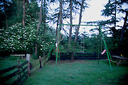 blurry view of a children swing in rural setting