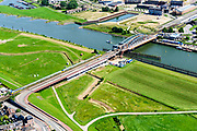 Nederland, Gelderland, Gemeente Zutphen, 17-07-2017; spoorbrug over de IJssel (IJsselkade) richting industrie- em bedrijventerrein.<br /> River IJssel with next to the railway bridge the station<br /> <br /> luchtfoto (toeslag op standard tarieven);<br /> aerial photo (additional fee required);<br /> copyright foto/photo Siebe Swart