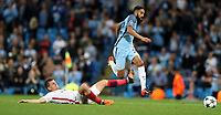 Football - 2016 / 2017 Champions League - Qualifying Play-Off, Second Leg: Manchester City [5] vs. Steaua Bucharest [0]<br /> <br /> Gael Clichy of Manchester City and Gabriel Enache of Steaua Bucharest during the match, at the Ethihad Stadium.<br /> <br /> COLORSPORT/LYNNE CAMERON