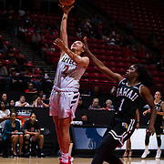 09 November 2018: San Diego State Aztecs guard Sophia Ramos (2) lays the ball up past Hawaii Warriors guard Rachel Odumu (1) in the third quarter. The Aztecs opened up it's regular season schedule with a 58-57 win over Hawaii Friday at Viejas Arena.