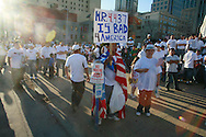 An estimated 12,000 people march and rally for immigration law reform.