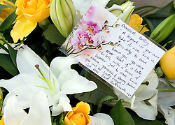 © Licensed to London News Pictures. 22/10/2011. Manchester, UK. Flowers left from Jane Butterworth the funeral of former Coronation Street actress Betty Driver at St Ann's Church in Manchester. The actress lived to the age of 91. Photo credit : Joel Goodman/LNP