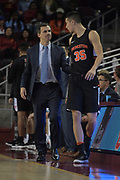 Dec 19, 2017; Los Angeles, CA, USA; Princeton Tigers head coach Mitch Henderson talks with forward Alec Brennan (35) during an NCAA basketball game at Galen Center. Princeton defeated USC 103-93 in overtime.