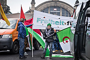 Frankfurt am Main | 16.12.2017<br /> <br /> On Saturday, December 16, 2017 about 1000 men, women and children take part in a demonstration march against the declaration of U.S. president Donald Trump to recognize Jerusalem as the capital of Israel and to relocate the U.S. Embassy in Israel from Tel Aviv to Jerusalem. The demonstration was registered under the slogan &quot;Demo f&uuml;r Jerusalem - Jerusalem/Alkudus ist die Hauptstadt Pal&auml;stinas&quot; (Demo for Jerusalem - Alkudus is the capital of Palestine).<br /> Here: Protesters in front of Frankfurt central railway station, a child holds a flag of Algeria.<br /> <br /> photo &copy; peter-juelich.com<br /> <br /> - Foto honorarpflichtig<br /> - No Model Release<br /> - No Property Release