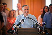 27 JULY 2011 - MESA, AZ:  Jerry Lewis (CQ) speaks from the podium at the Wright House in Mesa Wednesday. Lewis, a Republican, announced that he would run for the Arizona State Senate against incumbent Russell Pearce, who is the subject of a recall. Lewis is an accountant and charter school executive.     PHOTO BY JACK KURTZ