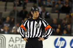 Dec 3, 2011; San Jose, CA, USA; NHL referee Chris Rooney (5) before the start of the second period between the San Jose Sharks and the Florida Panthers at HP Pavilion. Florida defeated San Jose 5-3. Mandatory Credit: Jason O. Watson-US PRESSWIRE