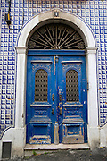 Old blue doors on a building with a ceramic tiled facade in the Lisbon.