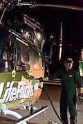 Pat DeVore, LifeFlight pilot, fills up the tank before taking off.