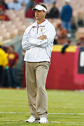September 11, 2010; Los Angeles, CA, USA;  Southern California Trojans head coach Lane Kiffin watches his team during warm ups before the game against the Virginia Cavaliers at the Los Angeles Memorial Coliseum.