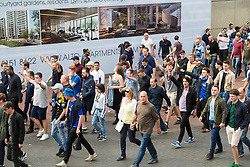 London, August 20 2017. A group of bold Chelsea fans make their way through the sea of Spurs fans as they head to the game where Tottenham Hotspur host their first game of the Premier League season at their temporary home ground, Wembley Stadium, hosting Chelsea FC. © Paul Davey.