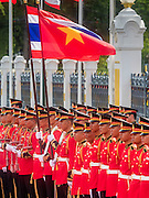 23 JULY 2015 - BANGKOK, THAILAND:  Thai soldiers with Thai and Vietnamese flags lined up to greet the Vietnamese and Thai Prime Ministers at Government House in Bangkok. The Vietnamese Prime Minister and his wife came to Bangkok for the 3rd Thailand - Vietnam Joint Cabinet Retreat. The Thai and Vietnamese Prime Minister discussed issues of mutual interest.     PHOTO BY JACK KURTZ