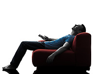 one caucasian man sofa couch remote control sleeping watching tv in silhouette isolated on white background