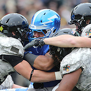 Air Force running back Jacobi  Owens is tackled during the Army Black Knights Vs Air Force Falcons, College Football match at Michie Stadium, West Point. New York. Air Force won the game 23-6. West Point, New York, USA. 1st November 2014. Photo Tim Clayton