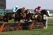Apples Jade and Jack Kennedy lead Clyne with Adam Wedge and Sam Spinner ridden by Joe Colliver into the first hurdle in the3.40pm The Ryanair Stayers' (Registered as the Liverpool) Hurdle (Grade 1) during the Grand National Meeting at Aintree, Liverpool, United Kingdom on 6 April 2019.