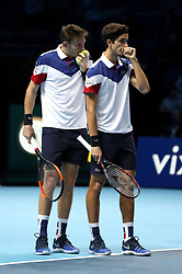 Nicolas Mahut and team mate Pierre-Hugues Herbert talk tactics during their doubles match against Horia Tecau and Jean-Julien Rojur during day one of the NITTO ATP World Tour Finals at the O2 Arena, London.
